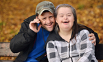 Down Syndrome couple in park